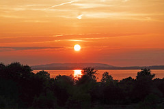 Spectacular sunset over the Chiemsee (rotraud_71) Tags: germany bavaria oberbayern chiemsee lake chieming sunset trees reflections backlight sky blinkagain