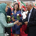 Maryam Rajavi offers flowers to political dignitaries at the celebration of the Relocation of Camp Liberty residents-4