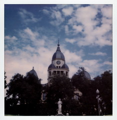 Courthouse-on-the-Square (tobysx70) Tags: the impossible project tip polaroid sx70sonar sonar instant color film for sx70 type cameras impossaroid courthouseonthesquare denton county texas tx courthouse john b statue clock tower blue sky clouds cloudporn trees polacon2016 polaconone 100116 toby hancock photography