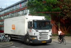 Cyclist passes Copenhagen City owned Scania P230 UB93907 (sms88aec) Tags: cyclist passes copenhagen city owned scania p230 ub93907