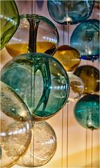 circles in glass (marneejill) Tags: glass ornaments balls handblown decorative colourful blue hanging green orange shadows light inside