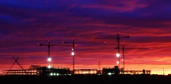 Construction Site Sunrise (Circled Thrice) Tags: hotel gaylordrockieshotel conferencecenter rockies denverinternationalairport dia construction sunrise sky cranes jobsite colorado aurora commercecity denver canon eos rebel t3i sigma landscape longexposure