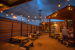 A storm is brewing at Deep Ellum Brewery (morten f) Tags: storm brewing brewery deep ellum tap room garden beer craft dallas texas night drinking people lights