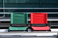Empty bleachers with seats side by side (yourbestdigs) Tags: infrastructure portugal freetime terraces chair bleachers seat spectacle empty noaudience green red