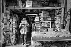 The bookworm (Tilemachos Papadopoulos) Tags: qoq urban fujinon fuji fujifilm mono monochrome people athens street books greece xt10 candid bw blackandwhite mirrorless