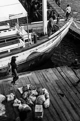 Sur les quais.. (Romain Roellet) Tags: thalande sur les quais thailand thailande docks sea fish fisher boats boat wood texture asia summer trip travel people street photography black white bnw bw