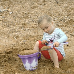 Sand Filled Bucket (Nic Rutterford) Tags: daughter girl beach sand bucket spade