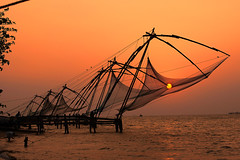 Chinese fish nets at sunset in Fort Cochin (Kochi) in Kerala, India (jitenshaman) Tags: travel sunset india asian fishing asia indian kerala icon destination tradition nets cochin kochi chinesefishingnets fishingnets subcontinent fortcochin chinesefishnets worldlocations fortkochin