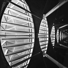 light blades (lunaryuna) Tags: madrid windows light bw architecture blackwhite airport lunaryuna terminal4 inarow scifibuffsunleashed scifiesque lightblades