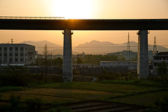 (memos to the future) Tags: china travel sunset train dusk tracks elevated goldenhour highspeedrail ktrain chinarailways