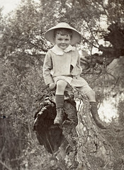 Boy on a tree stump. Scan of a glass negative. (benicektoo) Tags: vintage vintagephotographs foundphotographs