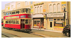 Passing the shops (kingsway john) Tags: model tram tramway e1r tramcar modl layout london transport shops high road kingsway models card building kits 176 scale