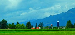 Red barns (peggyhr) Tags: peggyhr fraservalley red farm mountains clouds green blue white dsc00552a bc canada niceasitgets~level1 musictomyeyes~l1 level1peaceawards infinitexposurel1 thelooklevel1red level1photographyforrecreation thelooklevel2yellow level2photographyforrecreationsilveraward thelooklevel3orange infinitexposurel2 infinitexposurel3 flickrawardgroup thegalaxy 30faves~