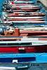 Line of fishing boats in Carril (basair) Tags: red sport nauticalvessel oar lake water outdoors healthylifestyle hobbies traditionalsport river kayak recreationalpursuit watersport leisureactivity boat madrid summercamp canoe canoeing summer pier fun floatingonwater activity riverbank modeoftransport tranquilscene recreationalboat nopeople vertical watersedge colorimage rowboat multicolored pond sea vibrantcolor galicia carril vilagarciadearousa