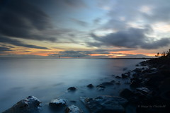 LoughNeaghSunsetSept2016-5 (CharlesM-2) Tags: charlesm charlesm2 shadowpm2 northernireland countyantrim nikon d7100 tokina 1116mm ireland uk unitedkingdom water sky clouds longexposure loughneagh lake rocks smoke sunset sun september 2016