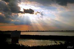 ___ squarcio di luce ! ___ (erman_53fotoclik) Tags: controluce squarcio luce cielo nuvole contrasti riflessi deltadelpo panasonik dmc tz25 erman53fotoclik valli rosolina tramonto orizzonte