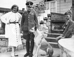 Concentration Camp Commandant and Family (olegczugujewets) Tags: adults armedforces armycorps blackandwhitephotography boys canine colonel couples domesticanimals domesticdog dwelling europe europeans families fascists fathers females few germanshepherd germans germany governmentagency house humanrelationships husbands ilsakoch intelligenceagency karlkoch males mammal men middleaged militaryofficers militarypersonnel mothers nazis offspring parents people perverts pets photography policeforce portraits relatives sadists sheepdog sons spouses ss thirdreich walkway whites wives women