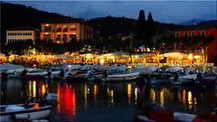 Garda at Lago di Garda at night (Ostseetroll) Tags: garda geo:lat=4557560212 geo:lon=1070511323 geotagged ita italia italien lagodigarda gardasee nachtaufnahme nightshot boote boats spiegelungen reflections