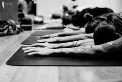 Grounded (JSTAR377) Tags: yoga stretch blackandwhite grounding closeup tattoo fingers arms mat lululemon
