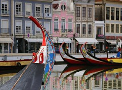 Canals and Moliceiros in the charming city of Aveiro (Bn) Tags: portugal aveiro moliceiros boat gondel traditionally charm magic hidden gem reflections water canals maritime colour fishermen paintwork azulejo fishing veice lagoon urban festival seaweed tourist holiday vacation pink yellow colors blue round city hopping ornate images man woman