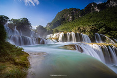 Bangioc waterfall in Caobang, Vietnam (:: Focus Studio ::) Tags: ban bang beautiful beauty blurred cao climate coastline down drop environment exposure extreme falling flowing forest gioc lake landscape lapse long majestic missioners motion mountain moving national natural nature object plant rainforest relaxation river rock speed spraying springtime stone stream summer sunlight terrain thac tropical vietnam water waterfall outdoor watercourse creek