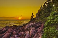 Bass Harbor Sunset [EXPLORE] (Moniza*) Tags: ocean park light sunset sea sky lighthouse seascape beach nature water silhouette clouds sunrise landscape dawn harbor twilight sand nikon rocks waves bass head maine rocky national bluehour acadia d90 moniza