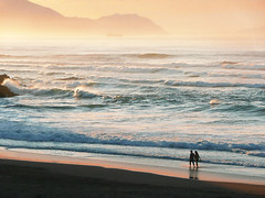two persons walking on beach at sunset (Mikel Martnez de Osaba) Tags: ocean sunset sea summer vacation two people woman man love beach water silhouette sunrise walking golden coast sand couple walk wave romance together shore romantic