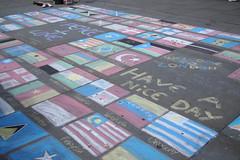 Welcome to London (skittledog) Tags: streetart london tourism chalk trafalgarsquare flags haveaniceday