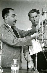 Professor Donovan Courville demonstrates equipment (PUC Special Collections) Tags: laboratory lab pacificunioncollege chemistrydepartment chemistrylab chemistry beakers test tubes scientist labcoat experiments angwin california adventist sda seventhdayadventist college