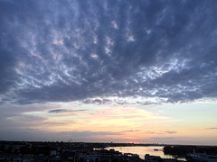 Night falls over Rostock and the river Warnow. (arwed.kubisch1) Tags: rostock night warnow river flus fluss cloudy clouds blue sky wolkig wolken blau himmel districts stadtteile radisson evershagen