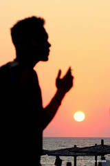 Smoking at the sunset (Frank Abbate) Tags: sunset silhouette tramonto marina mancaversa mare salento puglia italia beach man guy uomo ragazzo boy sigaretta cigarette cotriero ombrelloni ionio sea ionian italy italien smoke fumare canon eos 80d