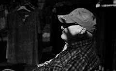 Mystery (Luis Alvarez Marra) Tags: salou spain catalonia bw black white monochrome nikon d7000 35mm candid outdoor fleamarket shadows decisive moment street tog streettog soul collecting