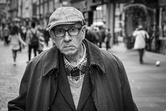 The Curious Mind (Leanne Boulton) Tags: people monochrome depthoffield outdoor urban street candid closeup portrait portraiture streetphotography candidstreetphotography candidportrait streetportrait streetlife eyecontact candideyecontact old elderly aged man male face facial expression glasses cap look emotion feeling atmosphere mood tone texture detail bokeh natural light shade shadow city scene human life living humanity society culture canon 7d character 50mm black white blackwhite bw mono blackandwhite glasgow scotland uk