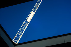 When your feet are made of stone (2 of 7) (Howard Sandford) Tags: architecture abstract bridgeoflight window skylight crane bluesky