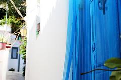 blue door (Katrinitsa) Tags: athens greece plaka anafiotika  architecture cityscape city acropolis neighbourhood street streets wall colors cityview view sunlight nature blue door white canon ef35mmf14lusm tulle