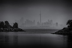 city in the mist (rick miller foto) Tags: toronto waterfront harbourfront towers city mist fog bw mono canada shoreline lake ontario harbour