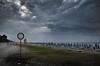 spiaggia negata (pamo67) Tags: pamo67 beachprohibited mare sea riva shore ombrelloni umbrellas nuvoloso cloudy grigio grey divieto segnale signal estate summer pasqualemozzillo minaccioso threatening