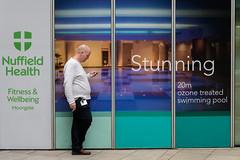 Stunning (Torsten Reimer) Tags: unitedkingdom man england london europa break advertisement mobilephone smoking moorgate europe uk candid gb