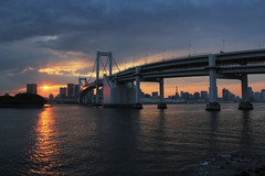 Rainbow Bridge Sunset (counteragent) Tags: city skyline clouds tokyo kitlens tokyotower  odaiba daiba dslr  hdr tokyobay rainbowbridge pedestrianbridge railbridge   trafficbridge  hdrblend 18135mmlens doubledeckbridge counteragent canoneos60d rainbowbridgesunsetbycounteragent rainbowbridgeatsunset
