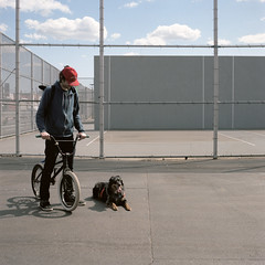Rob and Max, and Handball Court. Bushwick, Brooklyn. (jordanguile) Tags: dog mer mediumformat bmx handmade american bags handball bushwick hasselblad500cm 220film carlzeiss80mm