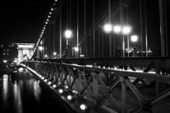 The Chain Bridge (eva urban) Tags: city blackandwhite bw reflection water night river lights hungary budapest structure lamps danube hd monumental lnchd chainbridge jszaka feketefehr dunapart fnyek