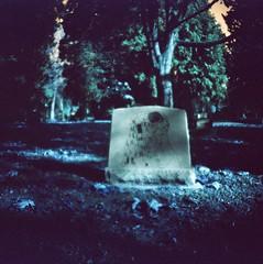 I shut my eyes and all the world drops dead; (liquidnight) Tags: diana dianaf analog analogue filmphotography lomochrome turquoise lomochrometurquoisexr100400 lomochrometurquoise mediumformat surreal dreamy dreamscape lomo lomography pnw toycamera lonefircemetery cemetery graveyard portland pdx oregon mementomori klimt gustavklimt kiss thekiss sylviaplath madgirlslovesong tombstone
