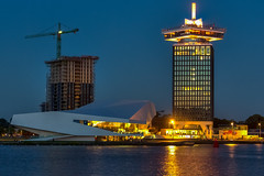 Adam Tower (roevin | Urban Capture) Tags: amsterdam noordholland netherlands nl thenetherlands bridge lights water steel pole beams nightshot longexposure architecture construction under reflection reflections light beam river ij sail hotel building adam tower lookout eye museum institute windows twilight sunset