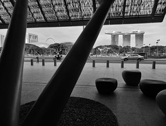 pebbles, rocks and the Sands (SM Tham) Tags: asia singapore nationalgallery entrance structure canopy pebbles seats sculpture standrewsroad padang marinabaysands esplanade theatres singaporeflyer trees bollards blackandwhite monochrome