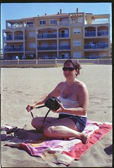 Spain 2016 - Retina Ib (018 Chrome Dot) - Lisa at the beach (TempusVolat) Tags: holiday spainholiday spain 2016 vacance summer gareth wonfor tempus volat mrmorodo tempusvolat garethwonfor kodak retina ib vintagecamera film 35mm scan scanned scanning scanner epson perfection v200 wife lisa girl woman holidaysnaps negative beauty beautiful brunette beautifulwife beautifulwoman prettywife attractive pretty lovelywife mywife mygirl gorgeouswife lovelylisa prettylisa goodlooking goodlooks spouse lover lovely love allure elegant cleavage mole tummy belly boobs voluptuous boob breast breasts demure shapely curvy curvaceous boobtube mobilephone sexy shorts shortpants short