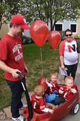 Getting them started young...triplets at a Nebraska football game (stevelamb007) Tags: nebraska lincoln footballfans triplets red balloons stevelamb nikon d7200 nikkor18200mm football game gbr huskers