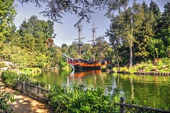 S.S. Columbia on the  Rivers of America (joe Lach) Tags: sscolumbia sailingshipcolumbia riversofamerica river trees reflection ship boat path disneyland california joelach