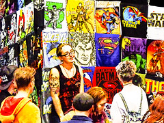 Looking for a Man of Steel (Steve Taylor (Photography)) Tags: tees tshirts batman superman raceyah doctortrance starwars green hornet thor hood twoface penguin hulk skull surfer top cap necklace stall art cartoon digital graphic logo colourful smile smiling fabric people man men woman women newzealand nz southisland canterbury christchurch addington outline texture armageddon costume outfit seller spectacles glasses sugarskull tattoo comic marvel dc manofsteel