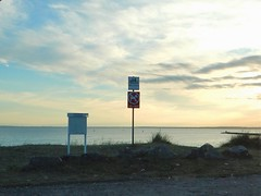 Signs at Knhaken naturistbad - R nude beach at sunset (Flicker Classic Person) Tags: knhaken naturistbad nudist naturist fkk skne helsingborg strand beach sweden sverige 2016 signs sign sunset resund safe