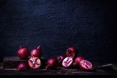 Pomegranates (saraghedina) Tags: foodphotography foodstyling fall pomegranate red purple fruit fresh stilllife stilllifephotography darkfood darkfoodphotography darkness chiaroscuro nopeople chiarosscuro canon